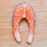 Fresh salmon fillet sliced flat lay on bamboo cutting board. Fresh salmon fillet sliced tempts buyers at fresh seafood stall. stock photos