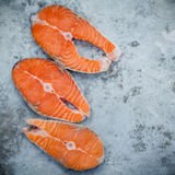 Fresh salmon fillet sliced flat lay on shabby metal background. Stock Image