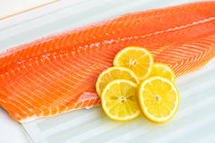 Fresh Salmon Fillet. With Slices of Lemon on White Background Stock Photo