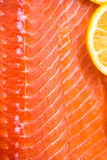 Fresh Salmon Fillet. With Slices of Lemon on White Background Stock Image