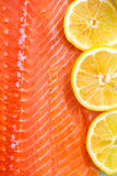 Fresh Salmon Fillet. With Slices of Lemon on White Background Royalty Free Stock Image