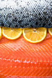 Fresh Salmon Fillet. With Slices of Lemon on White Background Royalty Free Stock Photo