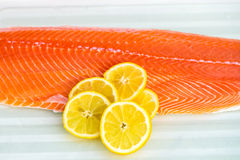 Fresh Salmon Fillet. With Slices of Lemon on White Background Stock Photography