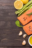 Fresh salmon fillet with spice on wooden background Stock Image