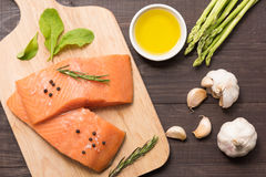 Fresh salmon fillet with spice on wooden background.  Stock Photo