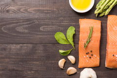 Fresh salmon fillet with spice on wooden background Stock Photos