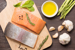 Fresh salmon fillet with spice on wooden background.  Stock Images