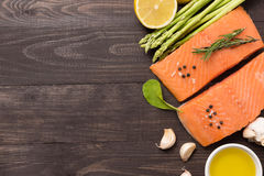 Fresh salmon fillet with spice on wooden background. Copyspace f Royalty Free Stock Photos