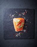 Fresh salmon fillet with spices and herbs Stock Photos