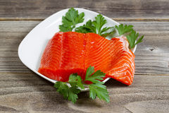 Fresh Salmon Fillet in white dish on rustic wood Stock Images