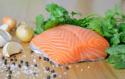 Fresh salmon fillet. On the wooden background Royalty Free Stock Photography