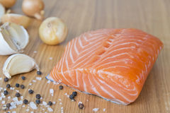 Fresh salmon fillet. On the wooden background Royalty Free Stock Photo