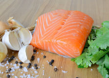 Fresh salmon fillet. On the wooden background Royalty Free Stock Images