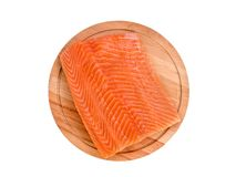 Fresh salmon fillet on wooden cutting board on white background,. Top view Royalty Free Stock Photo