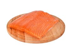 Fresh salmon fillet on wooden cutting board on white background,. Side view Royalty Free Stock Image