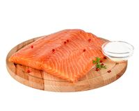 Fresh salmon fillet on wooden cutting board on white background,. Side view Royalty Free Stock Images