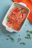 Fresh salmon fillets with onions, pepper and herbs Royalty Free Stock Photo