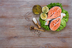 Fresh salmon fillets and spices. Royalty Free Stock Photos