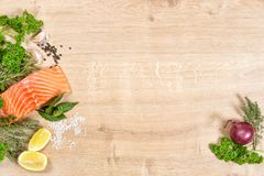 Fresh salmon fish fillet herbs spices Seafood Stock Photos