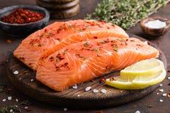 Fresh salmon fish fillet on wooden board. Closeup royalty free stock photo