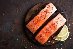 Fresh salmon fish fillet on wooden board. Top view royalty free stock photos