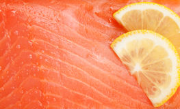 Fresh salmon fish with lemon slices Stock Photography