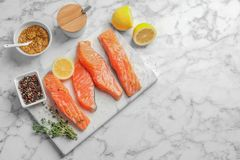 Fresh salmon and ingredients for marinade. On table, top view Stock Photography