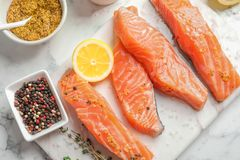 Fresh salmon and ingredients for marinade on table. Top view Stock Photo