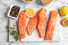 Fresh salmon and ingredients for marinade on table. Top view Stock Images