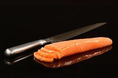 Fresh salmon isolated on black background. Whole fresh salmon fillet on mirrored black background Royalty Free Stock Photos