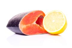 Fresh Salmon isolated on White Background. Fresh Raw Salmon with Lemon isolated on White Background Royalty Free Stock Photo