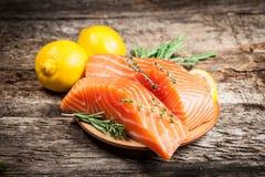 Fresh salmon with lemon. Still life royalty free stock images