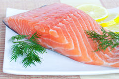 Fresh salmon with lemon and herbs. Fresh fish with lemon and dill Stock Images