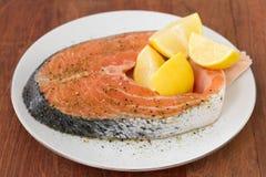 Fresh salmon with lemon Stock Photography