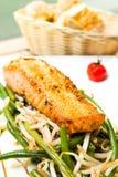 Fresh Salmon with lemon. A seafood salad with smoked salmon royalty free stock image