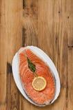 Fresh salmon with lemon on white dish Stock Photography