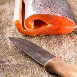Fresh Salmon with old knife on wooden board Royalty Free Stock Photo