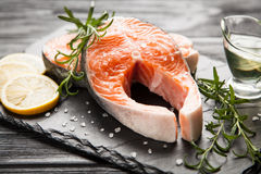 Fresh salmon on old wood Royalty Free Stock Photo