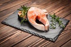 Fresh salmon on old wood Stock Photos
