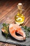 Fresh salmon on old wood Royalty Free Stock Photo