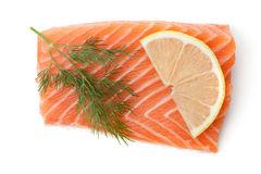 Fresh salmon piece with lemon slice and dill Stock Photos