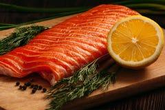 Fresh salmon piece on wooden board Stock Image