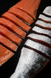 Fresh salmon pieces on dark black background stock photo