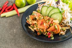 fresh salmon raw spicy salad Stock Image