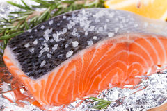 Fresh salmon ready for cooking. On the foil paper Royalty Free Stock Photography