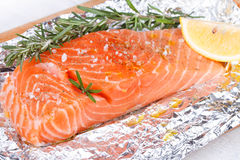 Fresh salmon ready for cooking. On the foil paper Royalty Free Stock Photo