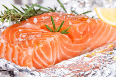 Fresh salmon ready for cooking. On the foil paper Stock Photo