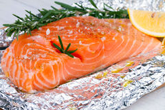 Fresh salmon ready for cooking on the foil paper. Royalty Free Stock Photography