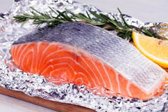 Fresh salmon ready for cooking on the foil paper. Stock Image