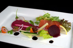 Fresh Salmon with Salad. On the white plate stock photo